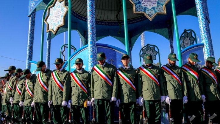 Members of Iran's Islamic Revolutionary Guard Corp (IRGC) attend a mass funeral in Iran of comrades who were killed fighting in Syria's civil war. The IRGC was designated a terrorist group in April, and is reportedly involved heavily in illegal drug production and trade. [Iranian Ministry of Defence]