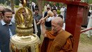 Thai Buddhist monk rings peace bell in Peshawar