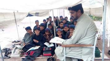 KP students defy militants by continuing education after bombings