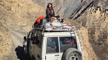Female hitchhiker gives thumbs up to travelling solo in Pakistan